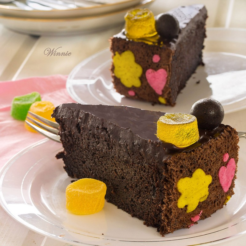 Irish Cream Chocolate Cake with swiss-roll decorated sides